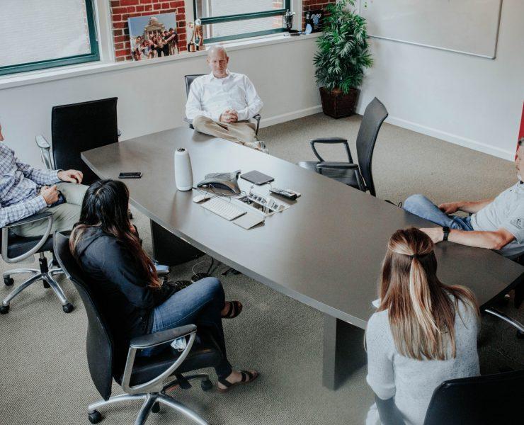 Meeting at conference table at Portland Webworks